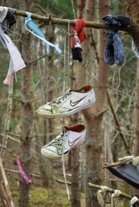 Dangling trainers at the Clootie Well